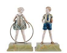 ϒ Ferdinand Preiss (1882-1943), Sonny Boy and Hoop Girl, two Art Deco cold painted bronze and ivory