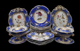 An English porcelain 'Rococo revival' blue-ground part dessert service painted with flowers, circa