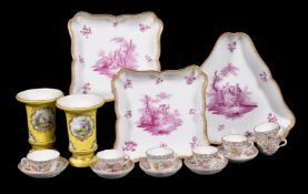 A pair of Meissen (outside decorated) shaped square dishes painted in puce with Watteauesque