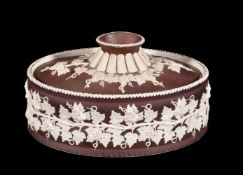 A Turner white stoneware and brown slip decorated pie dish and cover, circa 1800, sprigged in relief