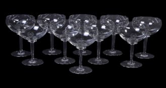 A set of ten modern champagne glasses from the Mirabelle restaurant, Mayfair, each with an acid-
