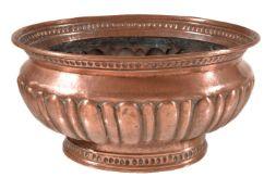 A Continental, probably Italian, repoussé copper wine cistern