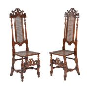 A pair of James II stained walnut and rattan side chairs
