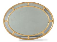 A giltwood and composition oval wall mirror, late 18th/ 19th century