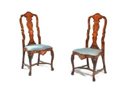 A pair of Dutch walnut and marquetry inlaid side chairs in 18th century style