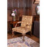 A George II walnut Gainsborough armchair