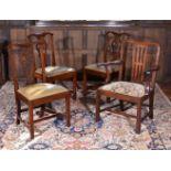A set of three George II mahogany chairs