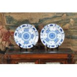 A pair of Dutch Delft blue and white chargers