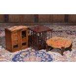 A mahogany table top revolving bookcase