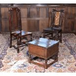 Two similar William III oak hall chairs, circa 1700