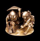 ϒ MUNEKAZU (SOICHI): A Japanese Ivory Okimono of two ronin