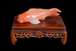 A Chinese or Japanese Carnelian agate small carp carving