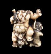 ϒ An Ivory Japanese Netsuke carved as the young Kintaro