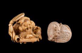 ϒ A Japanese Ivory Netsuke of a seated quail