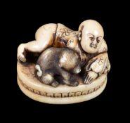 ϒ A Japanese Ivory Seal Netsuke of oval form