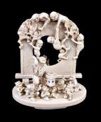 ϒ GYOKUSHU: A Japanese Ivory Okimono in the form of a tsuitate over which a mass of Oni swarm