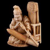 ϒ Sadamasa: A Japanese Ivory Okimono of a Seated Archer