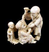 ϒ A Japanese carved Ivory Okimono of two blind men attacking each other