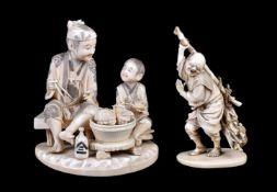 ϒ A Japanese Ivory Okimono of a man and boy