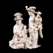 ϒ A Japanese Ivory Okimono of a kneeling Bijin