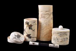 ϒ A Japanese Ivory Box and Cover of natural oval section decorated in high relief with a farmer