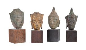 Four small bronze heads of Buddha Ayuthia Thailand c.17th century