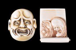ϒ A Japanese Ivory Netsuke in the form of a partially opened kakejiku