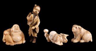 ϒ A Japanese Ivory Netsuke of Hotei