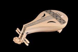 ϒ A Japanese Ivory Kogo in the form of a Biwa