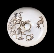 ϒ KAKYUSAI HIRONOBU: A Japanese Ivory Manju Netsuke of typical circular form