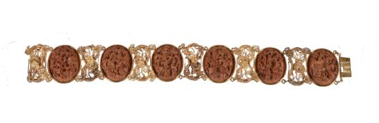 A Chinese gold filigree and peach stone bracelet attributed to Lee Ching