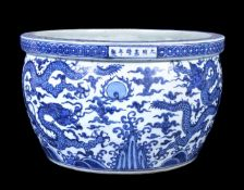 A large Chinese blue and white 'dragon' jardinière