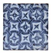 A Chinese square porcelain floor tile with underglaze blue decoration