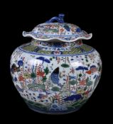 A large Wucai style 'Fish' jar and cover