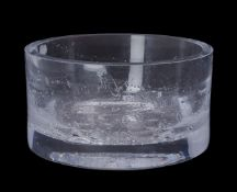 A clear cylindrical glass bowl, designed for Kelly Hoppen