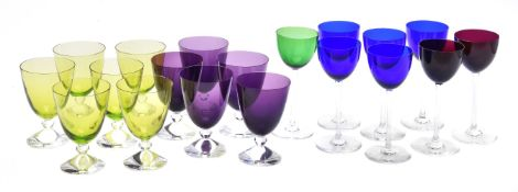 A selection of twenty-three Baccarat coloured drinking glass