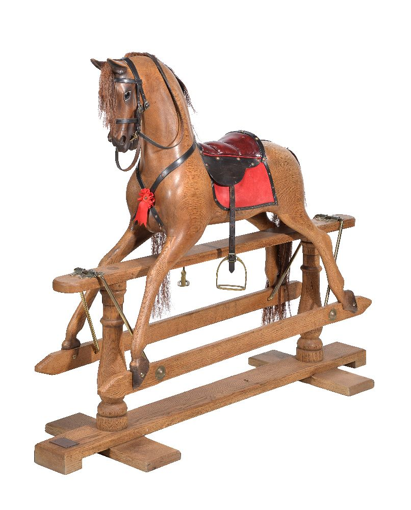Lot 131 - An oak rocking horse