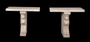 A pair of composite stone console tables in 18th century style