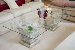 A rectangular glass topped coffee table