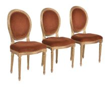 A set of three giltwood and upholstered side chairs in Louis XVI style