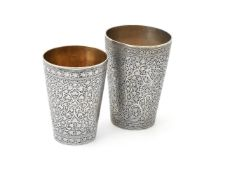 Two Indian silver tapered beakers