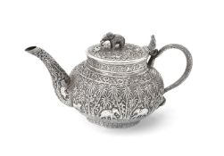 An Indian silver compressed spherical tea pot