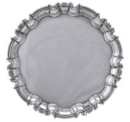 A silver shaped circular salver by William Hutton & Sons