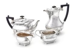 A matched silver four piece tea service by William Hutton & Sons