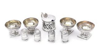 A set of four George III silver circular pedestal salt cellars by Peter