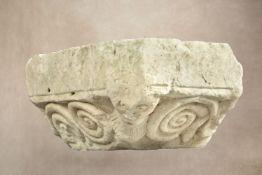 A carved limestone column capital,