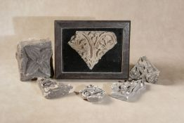 A group of five relief carved limestone fragments of Mediaeval Gothic tracery