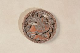 A Slavic carved boxwood pendant representing Saint George and the Dragon