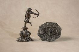 A Continental patinated bronze model of Cupid