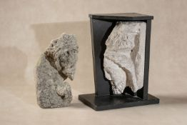 A sculpted limestone architectural fragment with the profile visage of a bearded man,